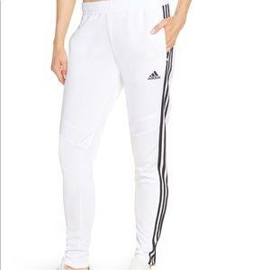 White Adidas jogger pants with black stripes
